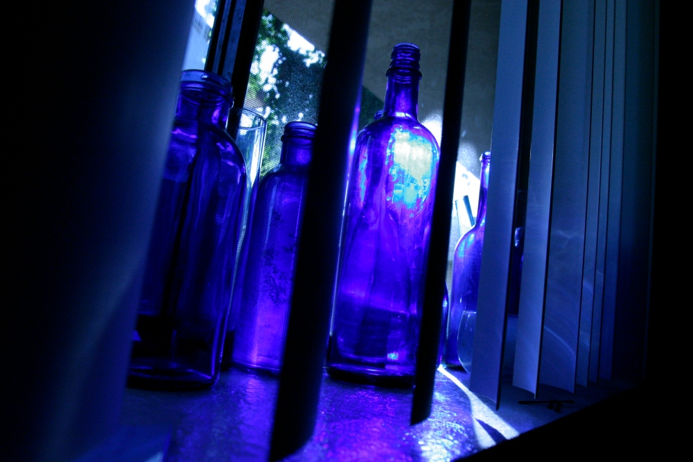 Brenda's blue bottle collection from our Ramona St. apartment. Blue light shining through the bottles gently reminds me that it's morning.